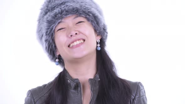 Thumbnail for Face of Happy Beautiful Asian Woman Smiling Ready for Winter