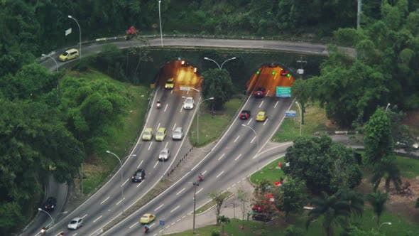 Thumbnail for Morning still shot of the fast traffic at a tunneled intersection in Rio de Janeiro.