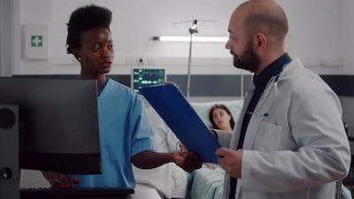 Black Assistant Typing Health Care Treatment on Computer