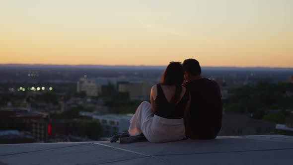 Thumbnail for Couple sitting and admiring the view from Mount Royal