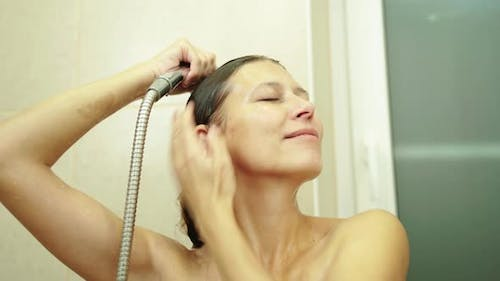 Woman Washes Her Hair With Shampoo In The Shower With Hair Care