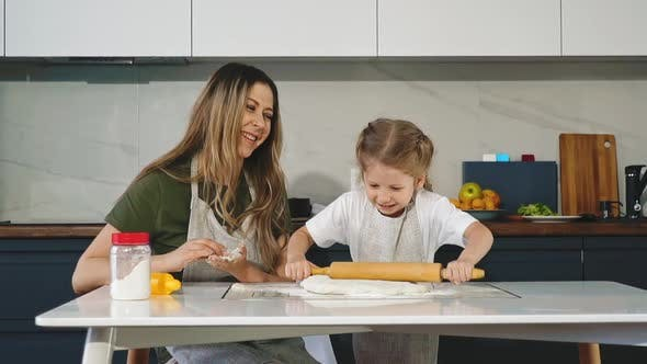 Thumbnail for Funny Girl Rolls Dough with Wooden Pin Cooking with Mommy