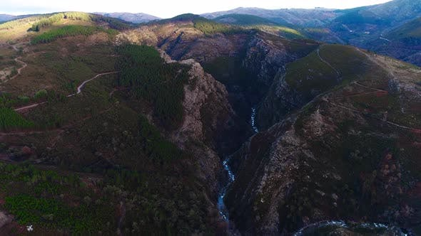 Thumbnail for Aerial Cinematic Drone View of Mountain Canyon