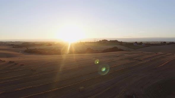 Majestic Sun Shining Above a Cleared Farming Land