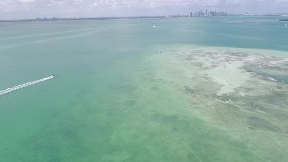 Thumbnail for Miami Aerial Following Boat Towards City