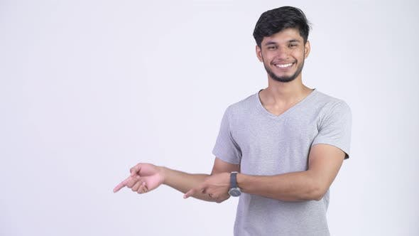 Thumbnail for Young Happy Bearded Indian Man Showing Something