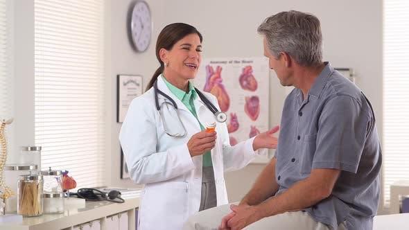 Thumbnail for Woman doctor prescribing medicine to elderly man