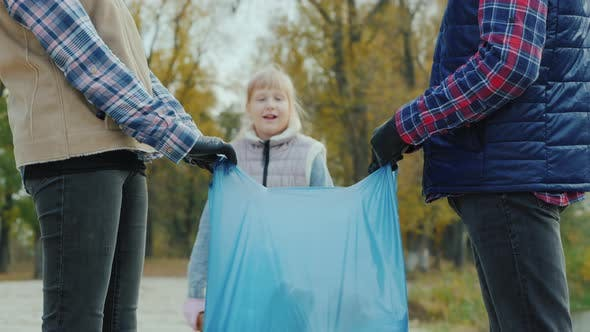 Thumbnail for Portrait of a Volunteer Child Collecting Trash in a Park