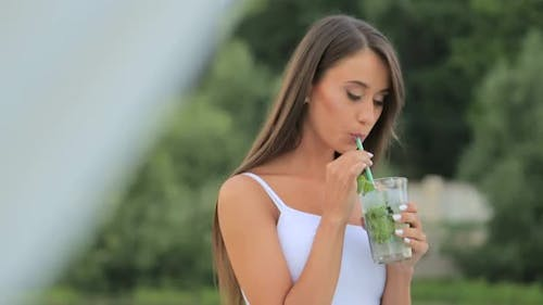 Young Beautiful Stylish Girl Drinks a Cocktail Beautiful Brunette