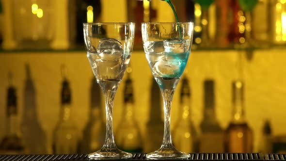 Thumbnail for Barman Puts Cubes of Ice Into a Glass, Pouring Different Alcohol Liquids, Turquoise, Using Gayser