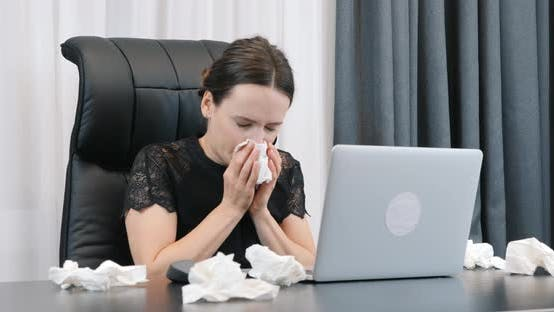 Thumbnail for Sick Woman with flu and runny nose in office