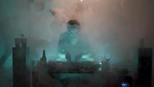DJ Playing Music in Smoke