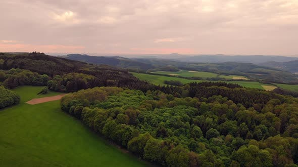 Thumbnail for Drone Flying Above Wood Cloudy Sky