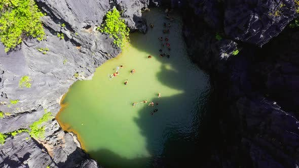 Thumbnail for Chinese and Korean tourists swim inside the small secret lagoon surrounded by the rocky mountains