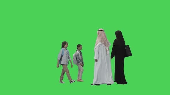 Arabic Adult Parents with two Children walking