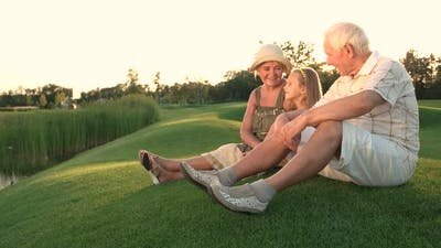 Grandparents and Granddaughter Outdoors.