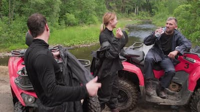 Quad Bike Riders Resting in Forest