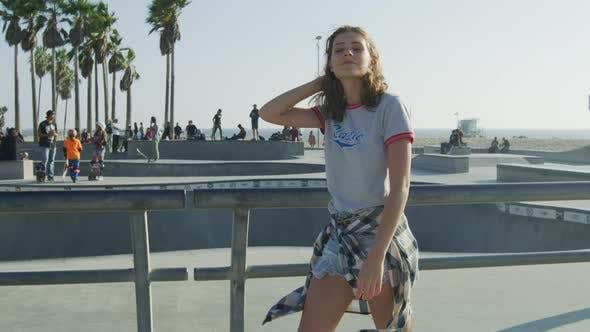 Thumbnail for Girl walking by the skatepark in Venice Beach
