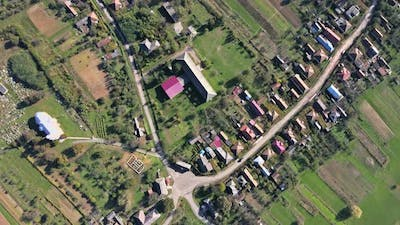Aerial View of the European Beautiful Village with Fields