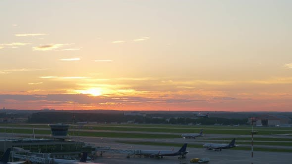 Thumbnail for View of Airport at Sunset, Plane Taking Off