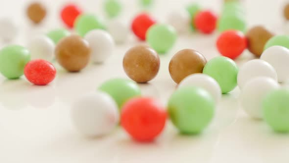Thumbnail for Colorful round candies on white reflective surface 4K 2160p UltraHD footage - Colorful round bonbons