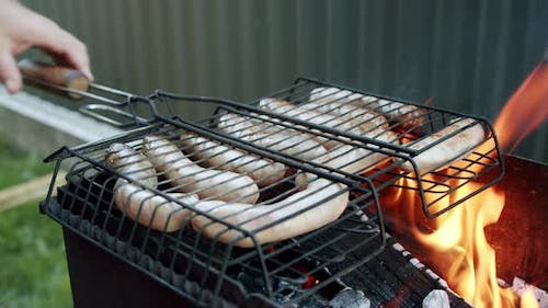 Sausages Are Fried on an Open Fire, Close Up Slow Motion V4