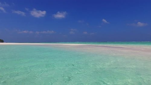Wide above clean view of a sunshine white sandy paradise beach and blue sea background in high resol