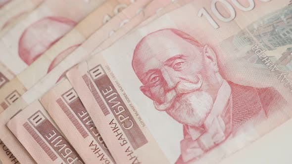 Thumbnail for Pile of denominations of 1000 dinars shallow DOF slow tilt 4K 2160p 30fps UltraHD  footage - Serbian