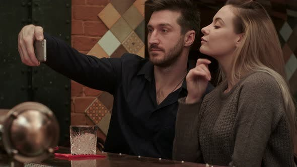 Thumbnail for Happy Couple with Drinks in the Bar Taking Funny Selfie Via Smartphone