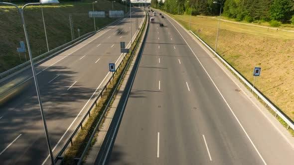 Evening traffic on the highway, tilt time-lapse