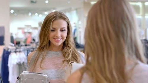 Beautiful Woman Choosing Clutch Bag