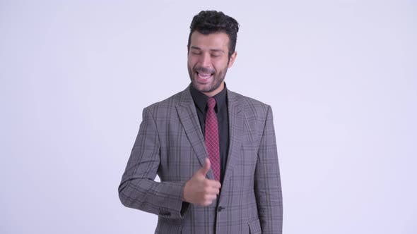 Thumbnail for Happy Bearded Persian Businessman Giving Thumbs Up