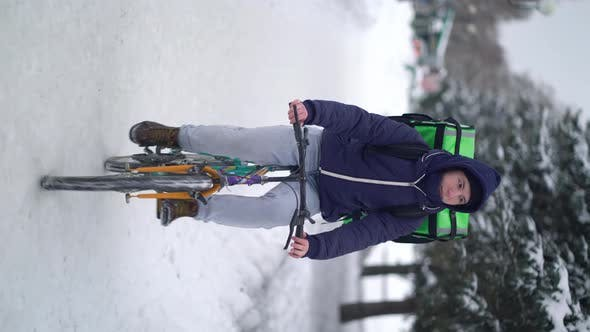 Thumbnail for Courier Is Delivering Food with Backpack at Winter