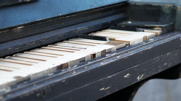 Thumbnail for Old Rusty Piano Outdoors. Overview of a Keyboard of an Old Piano. Antique Music Instrument