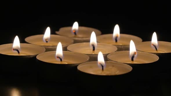 Thumbnail for Lit Candles Rotating Around