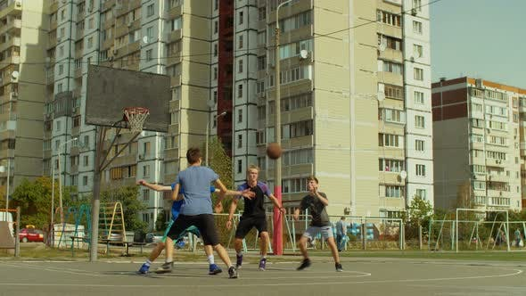 Thumbnail for Teen Streetball Players Playing Basketball Game