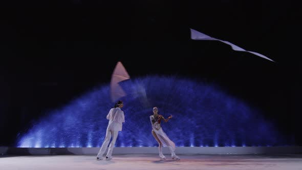 Couple with kites dancing on the ice
