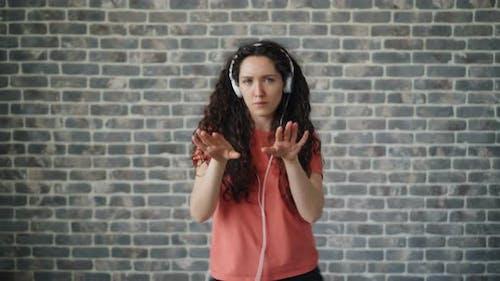Portrait of Cheerful Dancer Listening To Music in Headphones Dancing Relaxing