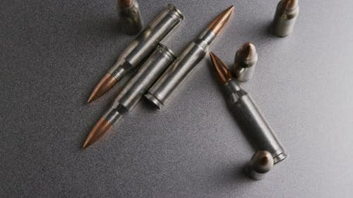 Cinematic rotating shot of bullets on a metallic surface - BULLETS 008