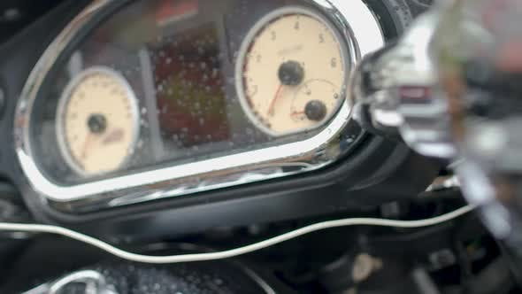 Thumbnail for Motorcycle Speedometer and Control Panel with Raindrops, Trade Show Closeup