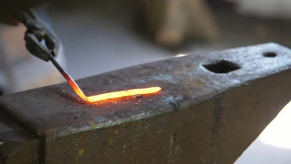 Thumbnail for Blacksmith Bending a Metallic Rod To Make an Iron Rose in a Dim Smithy in Ukraine