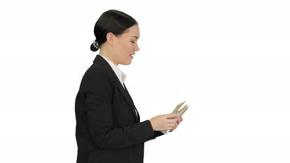 Thumbnail for Happy Business Woman Counting Money While Walking on White Background