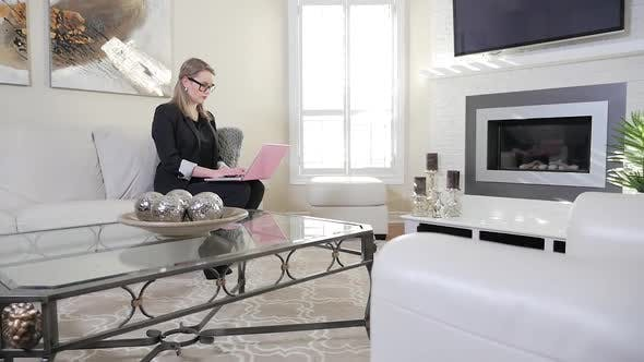 Thumbnail for A Young Female Business Entrepreneur Typing On Her Laptop Computer In A Beautiful Living Room 1