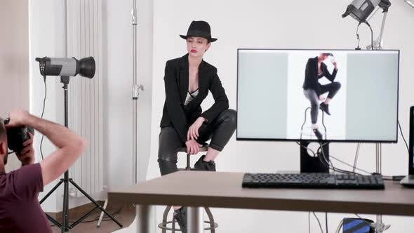 Thumbnail for Backstage of Professional Photo Shoot Where Photographer Is Taking Pictures of the Model