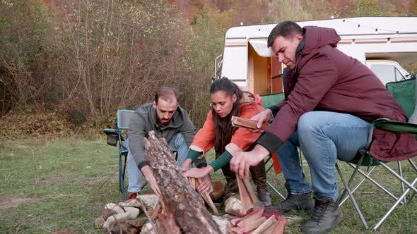 Thumbnail for Couple and Their Close Friend Preparing Camp Fire
