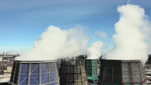 Cover Image for Aerial Drone View of Smoking Pipes and Cooling Towers of Coal Thermal Power Plant