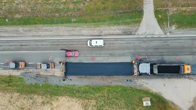 Aerial View Road Service Lays Asphalt on the Road