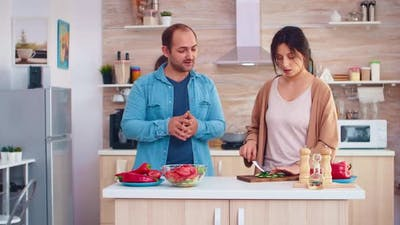Married Couple Preparing Salad