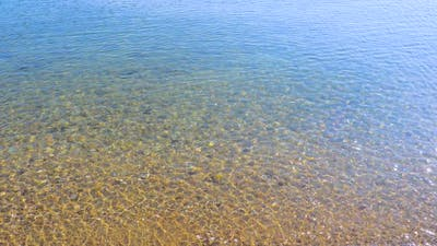 Crystal Clear Seawater. Summer Concept. Word Summer. Pebbled Seabed. Stones Under Water. Climate