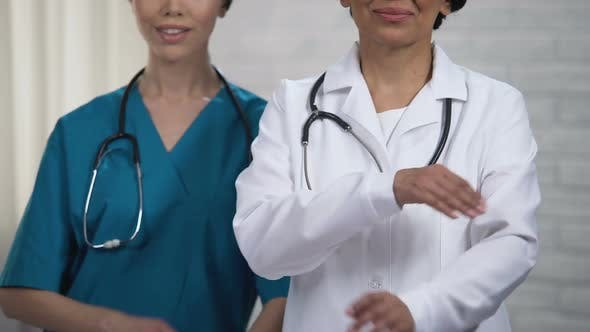 Thumbnail for Physicians Smiling and Crossing Hands, Highly Qualified Help of Medical Staff